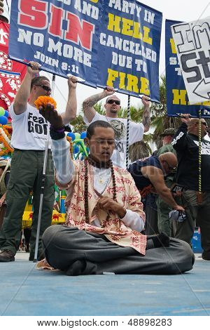 Hare Krishna meditating between Christians protest in the 37th Annual Festival of the Chariots
