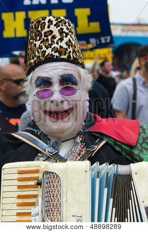 Man with painted face and playing accordion in the 37th Annual Festival of the Chariots