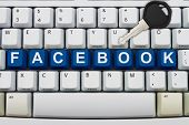stock photo of keyboard  - Computer keyboard keys with word Facebook and a key Protecting your Facebook information - JPG