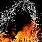 image of bonfire  - Fire flames with water splash over black background - JPG