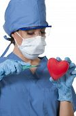 picture of open heart surgery  - Beautiful young woman cardiology surgeon performing surgery - JPG