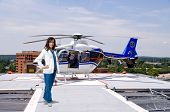 foto of medevac  - Woman doctor and a mobile flying ambulance better known as a life flight - JPG