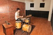 Drummer In A Brick And Wood Studio Jamming
