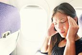 foto of sick  - Fear of flying woman in plane airsick with stress headache and motion sickness or airsickness - JPG