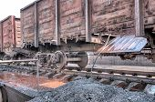 stock photo of boxcar  - A long line of boxcars cleaned of debris - JPG