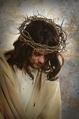 stock photo of thorns  - Portrait of Jesus with crown of thorns over old wall background - JPG