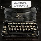 pic of old vintage typewriter  - Old antique black vintage typewriter and paper with text telling everthing is going to be alright  - JPG