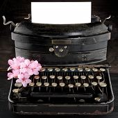 picture of black-cherry  - Old antique black vintage typewriter and empty paper for copy space with pink romantic cherry blossom flowers - JPG