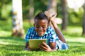 Outdoor Portrait Of Student Black Boy Using A Tactile Tablet - African People
