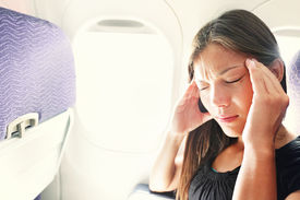 picture of aeroplan  - Fear of flying woman in plane airsick with stress headache and motion sickness or airsickness - JPG