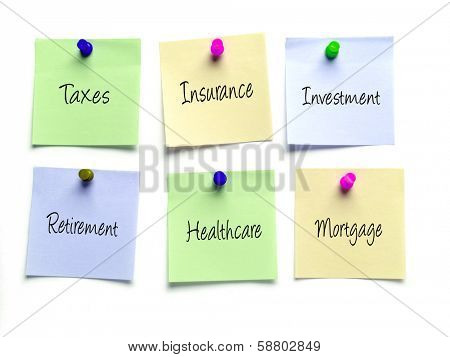 Six notes as a reminder of taxes, insurance, investment,retirement,healthcare and mortgage obligations