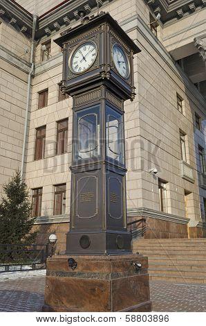 Krasnoyarsk, Russia - Nov.09, 2012: Street clock on a pedestal in Nov.09, 2012 in Krasnoyarsk, Russi