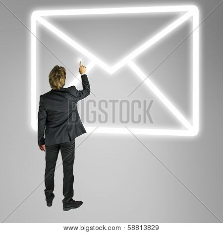 Businessman In Front Of A Mail Icon