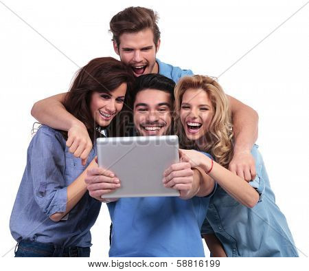 excited group of friends reading surprising stuff on their tablet pad computer on white background
