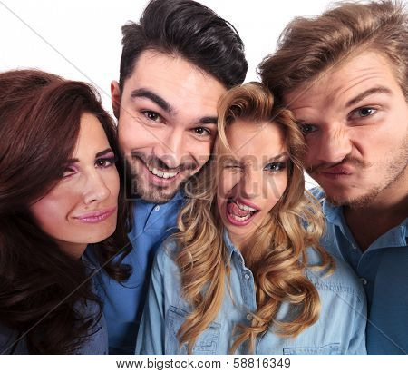 funny wide angle picture of casual people fooling around and making faces