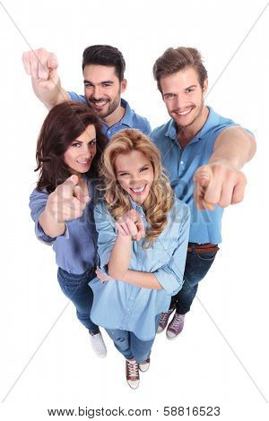 wide angle picture of young group of people pointing fingers to the camera