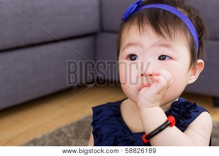 Baby sucking finger in mouth