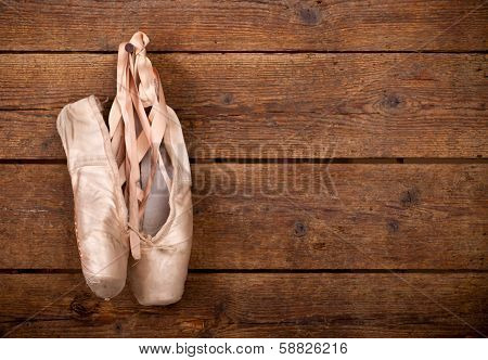 Old Used Pink Ballet Shoes Hanging