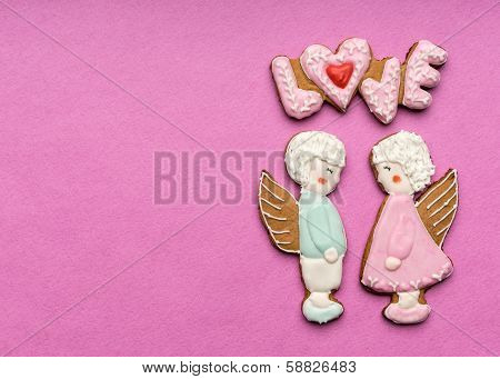Cookies with  text of love and couple of angels on Valentine's day
