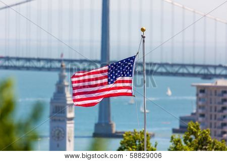 San Francisco USA American Flag Bay Bridge and Embarcadero Clock Tower from Telegraph Hill