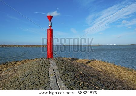 Beacon on a dike in a lake