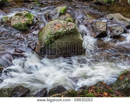 a creek with rocks and running water. landscape experience in nature.