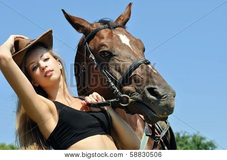 Young Attractive  Woman And Horse