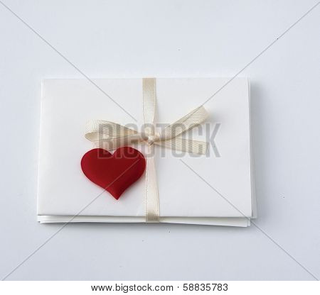 Postcard with red hearts, isolated on white background