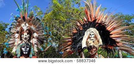 TULUM, MEXICO - JANUARY 25, 2011: Mayan unidentified warriors with traditional costume and feather masks in a traditional ritual dance, Tulum, Mexico, January 25, 2011.