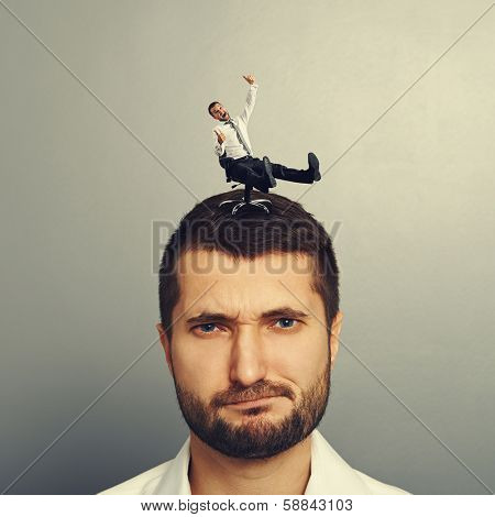 small joyful man rolling on the head big dissatisfied man