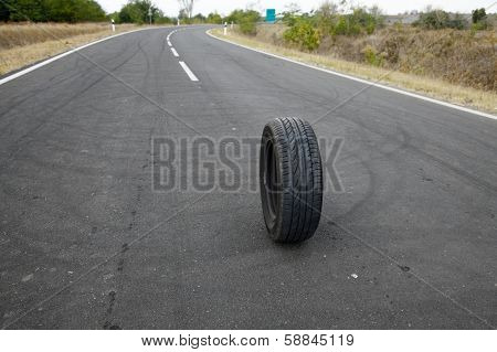 Wheel of a car on a road
