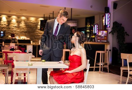 Tender man with his girlfriend in restaurant, affectionate couple
