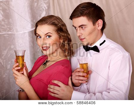 Couple on party drinking champagne . Black and white retro.