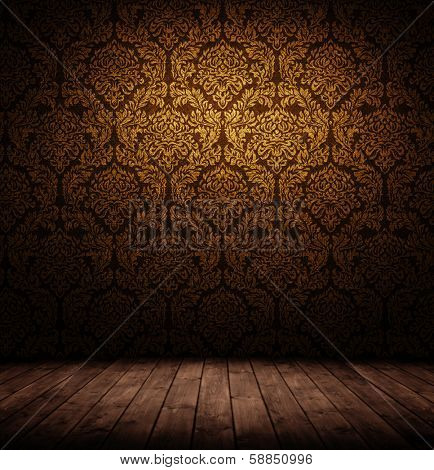 grunge interior with wooden floor and baroque wallpaper.