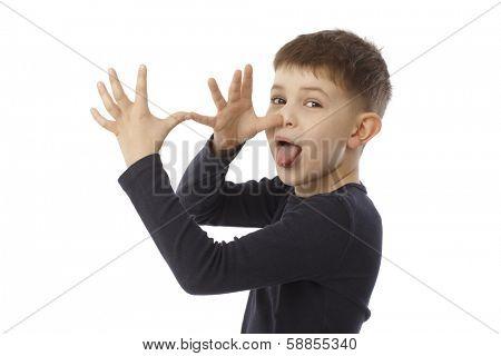 Little boy sticking tongue, mocking.