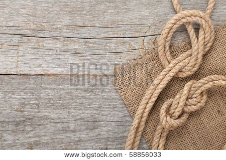 Ship rope on old wooden texture background with copy space