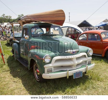 1954 Chevy 3100 Pickup With Wooden Canoe On Top
