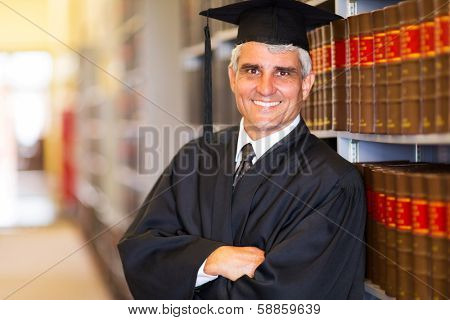 portrait of senior graduate with arms crossed in library