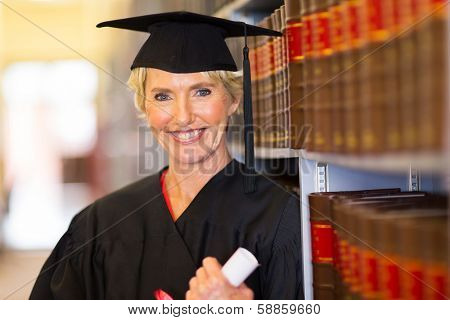 elegant middle aged female law school graduate in library