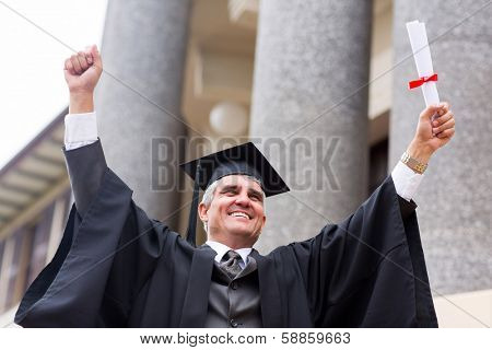excited middle aged university graduate with arms outstretched