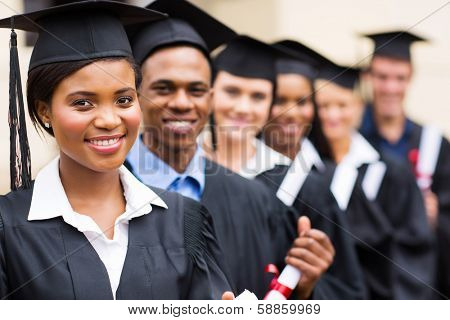 group of multicultural university graduates standing in a row