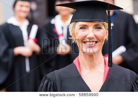 pretty middle aged university professor at students graduation ceremony