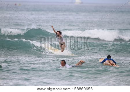 Girl wipes out surfing