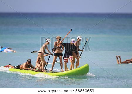 Group Stand Up Surfing