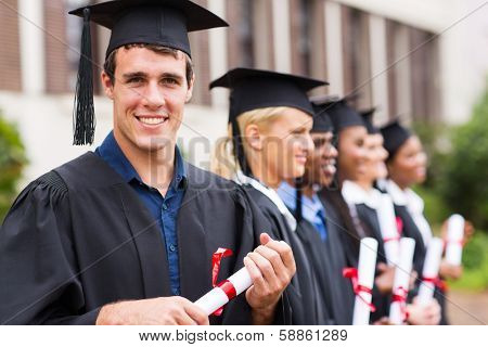 portrait of group cheerful college graduates at graduation