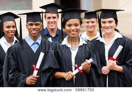 portrait of multiracial graduates holding diploma