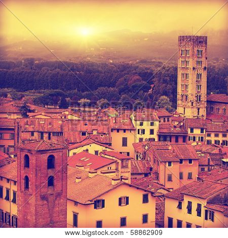 Vintage image of Lucca at sunset, old town in Tuscany.