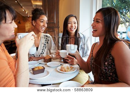 Group Of Female Friends Meeting In Caf���© Restaurant