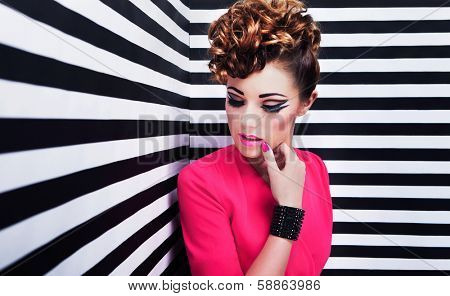 Portrait of beautiful young woman with professional party make up false eyelashes