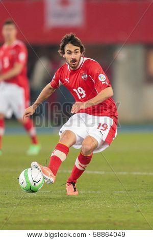 VIENNA,  AUSTRIA - MARCH 22 Veli Kavlak (#19 Austria) kicks the ball during the world cup qualifier game on March 22, 2013 in Vienna, Austria.